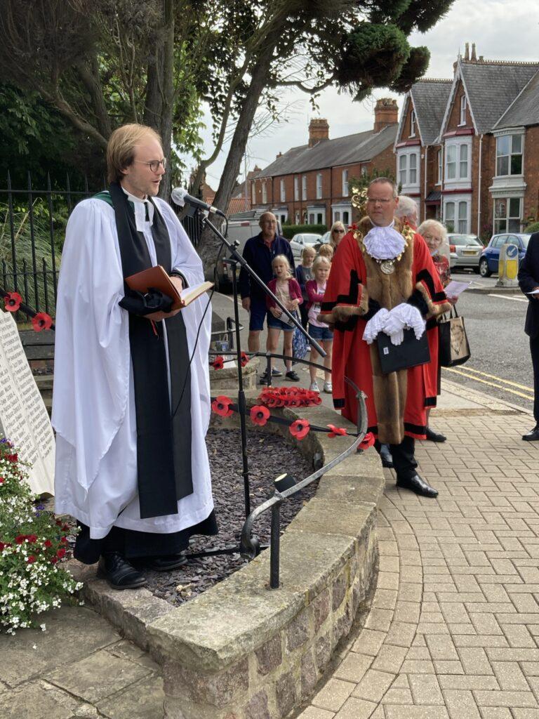 Rev'd James Robinson conducts service