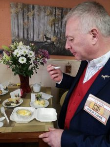 Guest Judge Colin Young tests the pies in the Toadstool Cafe on Queen Street