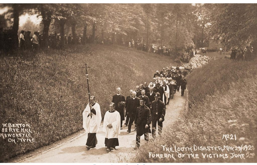 Procession in the distance at Louth Cemetery