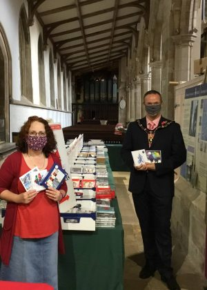 Mayor opening charity christmas cards at St James Church