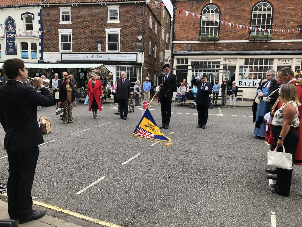 the Royal British Legion lowered the Standard in a 2-minute silence following the Last Post played by Adam Barter.