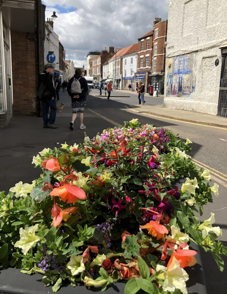Queen Street Louth showing flowers in July 2020